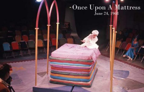The princess climbs into bed in a production of Once Upon a Mattress.
