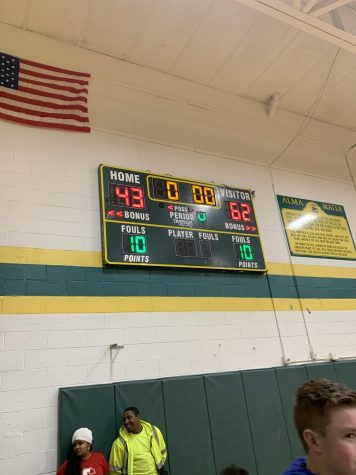 The scoreboard reflects the final score of the Carroll vs. LC varsity boys basketball game Friday