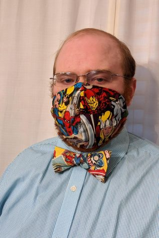 Mr. Devin Gallagher shows off one of his matching bow tie-and-face-mask sets.