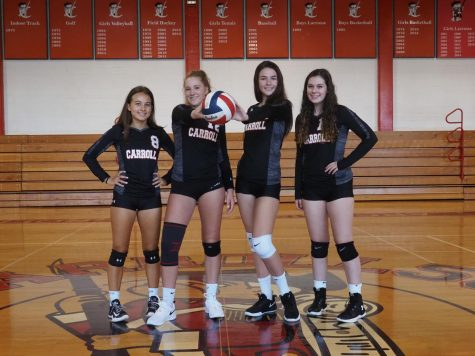 Kerry Ann Dillon (second from right) stands with some of her volleyball teammates.