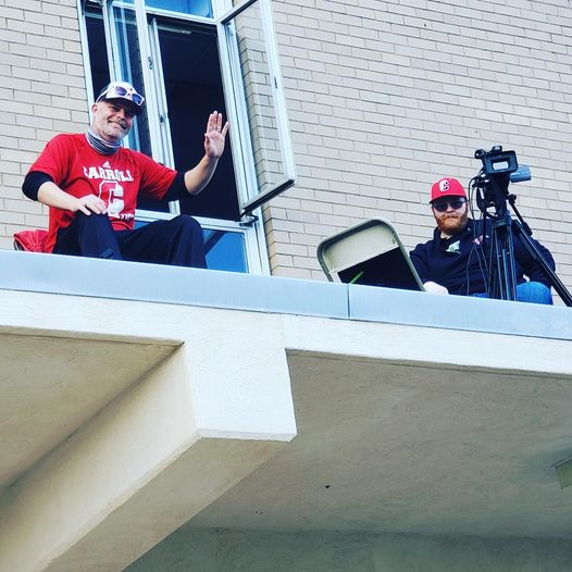 Mr. Ed Scanlan is high on the rooftop to announce a girls soccer game while Mr. Devin Gallagher handles the camera and the livestreaming.