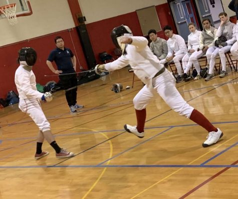 An Archbishop Carroll fencing team member goes after an opponent during a match last year.