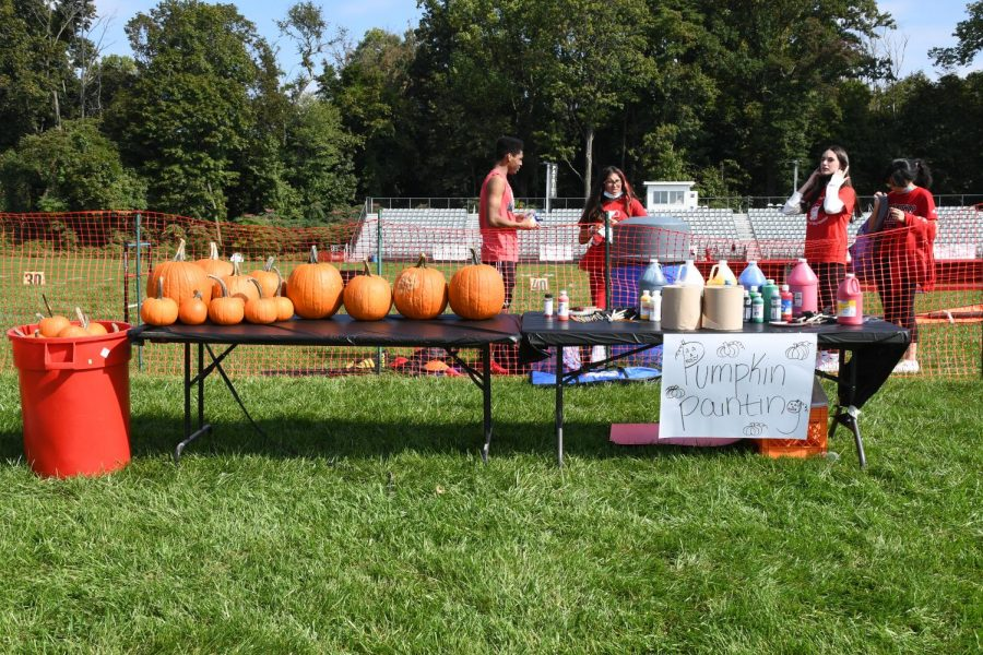 The pumpkin painting station awaits students during the homecoming tailgate party.