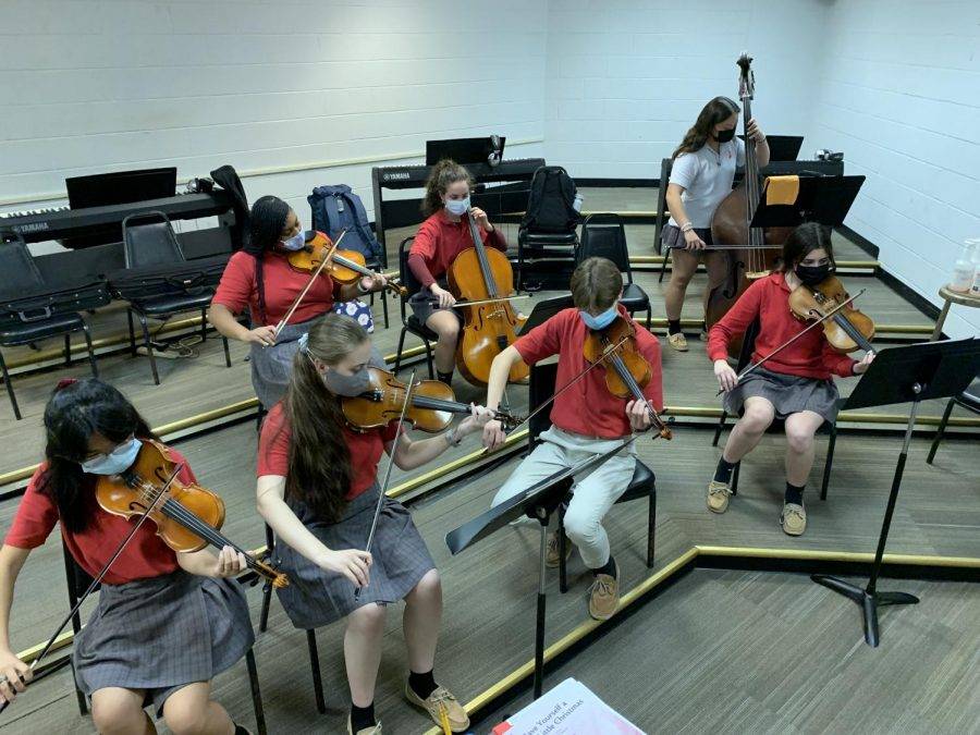 The String Ensemble works hard to perfect its performance.