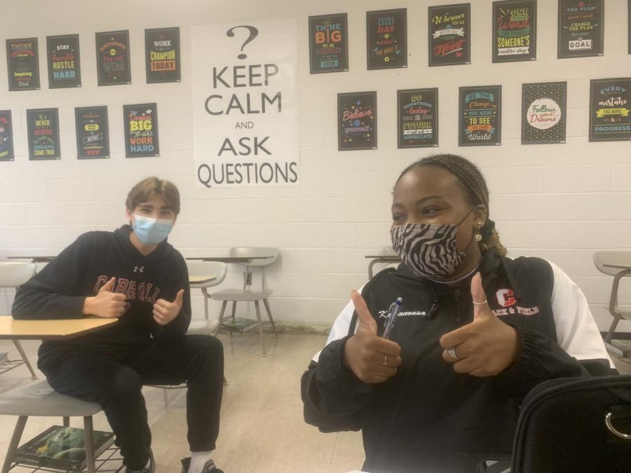 Juniors Gabe Petrecz and Lucia Kamanousa wear masks in their Honors Journalism class.