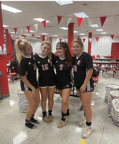 Seniors Reagan Duzy (far left), Amanda Armstrong (second from right), and Emma Talago (fra right) celebrate Senior Night and victories over rival OHara with junior Ella Wright (second from left).