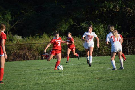Rebecca Wallgren takes a shot for Carroll.